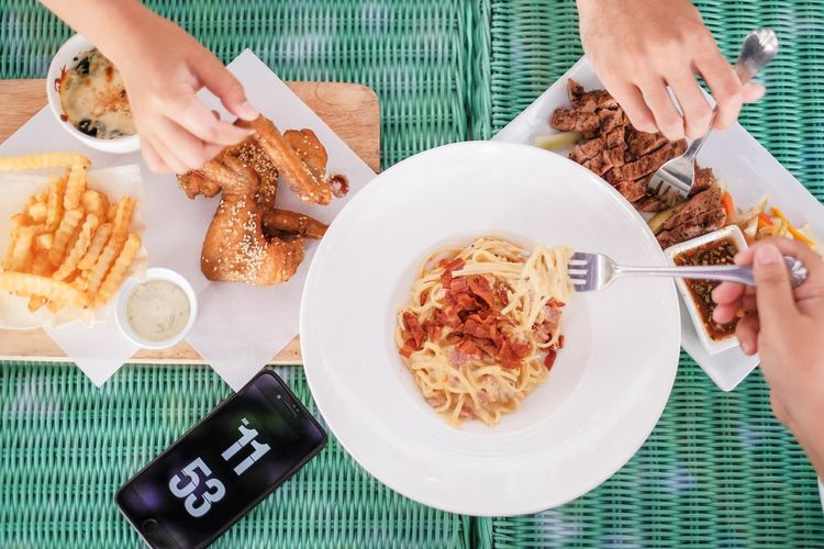 Eating Utensil Finger Food Food And Drink Fork Freshness Hand Holding Human Body Part Human Hand Indoors  Italian Food Kitchen Utensil Meal Meat One Person Pasta Plate Ready-to-eat Real People Spaghetti Table Women