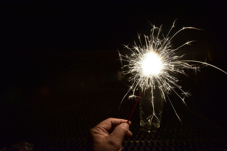 Hand holding sparkler firework at night Human Hand Human Body Part Holding Celebration Human Finger Firework - Man Made Object One Man Only Arts Culture And Entertainment One Person Night Only Men Firework Display Sparkler People Illuminated Close-up Adult Adults Only Indoors  Sky Bradley Olson Bradleywarren Photography Galena, Illinois Sparklers Room For Copy