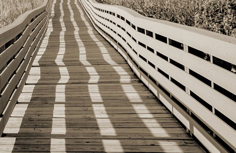 Shadow On Empty Boardwalk