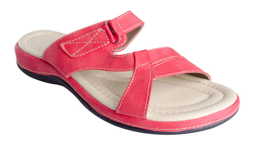 Close-up of sandal on white background