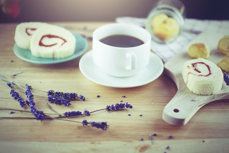 Close-up of coffee and cake on table