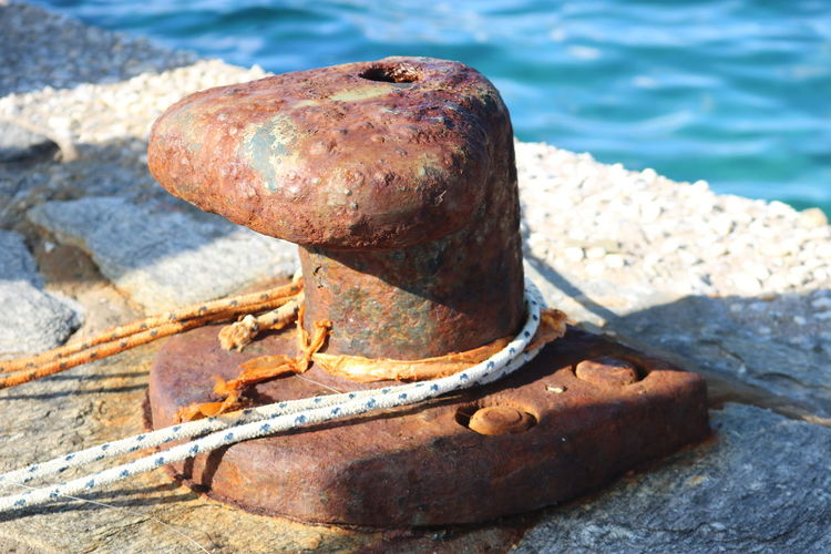 Close-up of rusty metal on sea shore