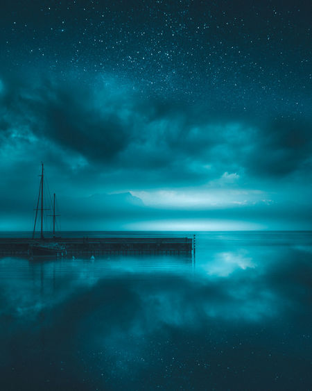 Beauty In Nature Cloud - Sky Horizon Horizon Over Water Idyllic Land Nature Night No People Outdoors Power In Nature Reflection Sailboat Scenics - Nature Sea Sky Tranquil Scene Tranquility Water Waterfront