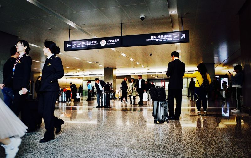 Group Of People Real People Indoors  Crowd Travel Men Large Group Of People Flooring Mode Of Transportation Public Transportation Full Length Architecture Passenger Walking Transportation Lifestyles Airport Terminal Railroad Station Airport Ceiling