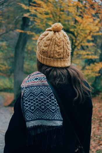 warm clothing Headwear Cold Temperature Fall Autumn Warm Clothing Young Adult Young Women Knitted  Warm Clothing Women Autumn Human Back Rear View Wool Waist Up Knit Hat Overcoat Leaves Hiker Friend Wearing Trench Coat Knitted  Autumn Mood