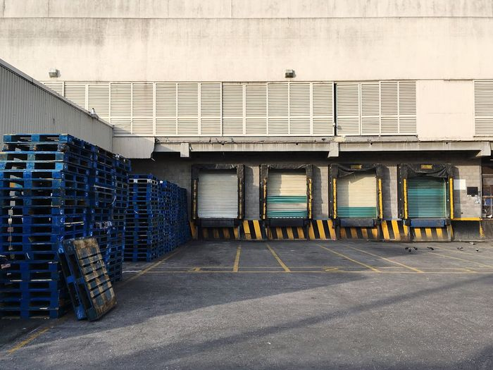 Stacked pallets on street outside factory