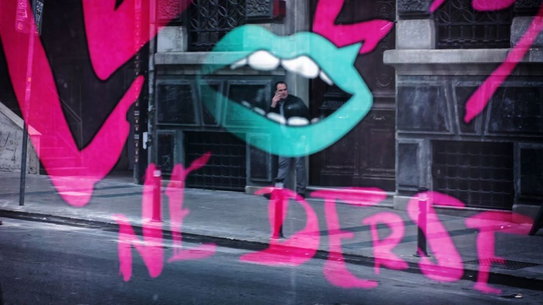 lip 💋 One Person Street Streetphotography EyeEm Reflection Street Photography Urban Istanbul Neon Text Multi Colored Architecture Building Exterior Built Structure Street Art Aerosol Can Art High Street Street Scene