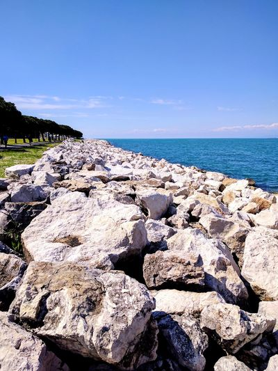 Beach Sea Nature Rock - Object Outdoors Summer Tranquility Landscape Horizon Over Water Sky Beauty In Nature Day Sunlight Water Sky And Clouds Slovenia Stone Rocks Seaview Sunny Beach Life Cloud - Sky Close-up Sea And Sky Blue