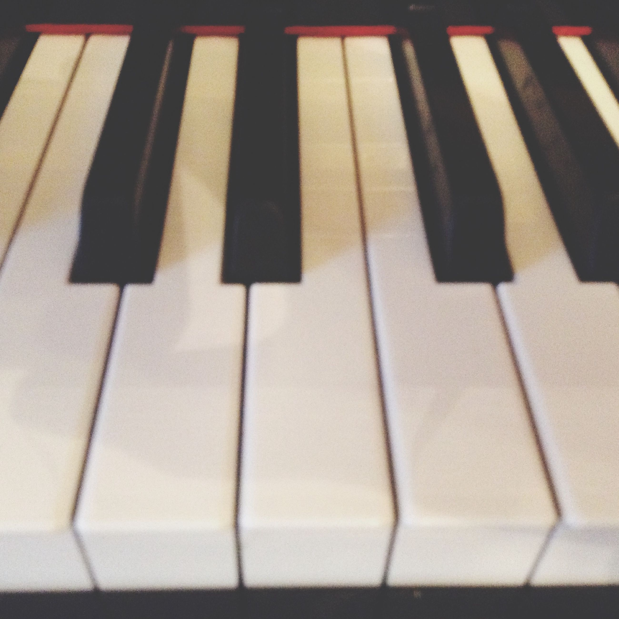 indoors, in a row, still life, close-up, high angle view, repetition, order, side by side, arrangement, no people, pattern, table, full frame, piano key, large group of objects, backgrounds, piano, selective focus, music, variation