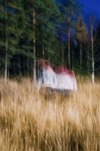 Blurred motion of train on field
