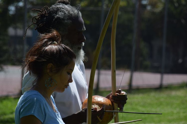 Amateurphotography Berkeley, CA Capoeira Culture And Tradition Elderly And Youth Focus On Foreground Learning Nikon_photography Nikonphotography Park Real People Streetphotography Teacher And Student Teaching The Youth