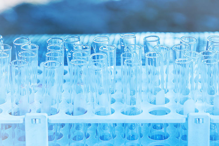 Lab science research glass items Abundance Backgrounds Blue Close-up Container Education Full Frame Glass Glass - Material Healthcare And Medicine In A Row Indoors  Large Group Of Objects No People Order Research Science Side By Side Test Tube Rack Transparent Water