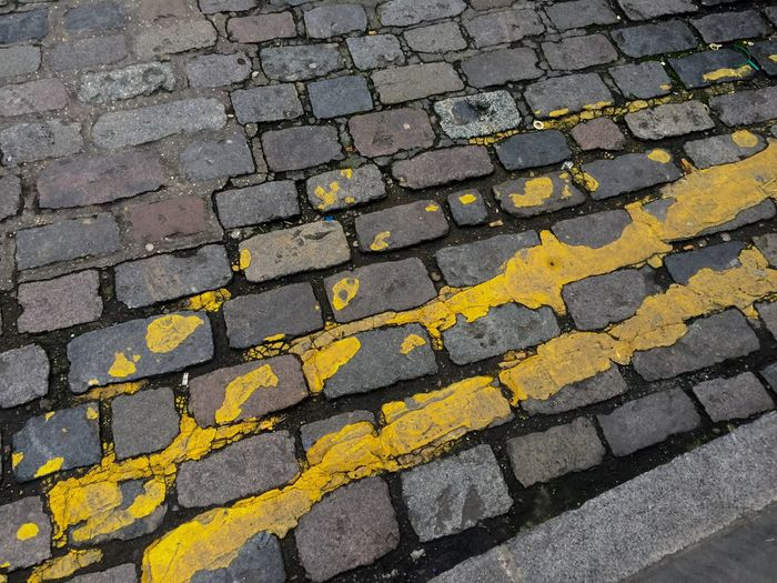Full Frame Backgrounds Stone Tile Outdoors Day No People Close-up yellow lines Parking Restrictions Art Is Everywhere