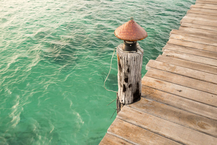 Lamp on wooden pier by lake