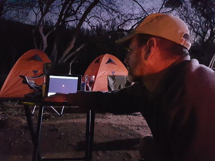 Man using mobile phone at night