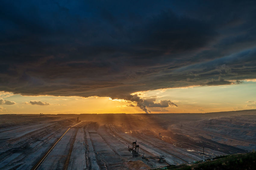 Hambach surface mine at sunset Hambach Surface Mine Sunset Cloud - Sky Sky Scenics - Nature Beauty In Nature Tranquil Scene Environment Nature Tranquility Landscape Transportation Non-urban Scene Winter Land Orange Color Snow Cold Temperature Outdoors No People