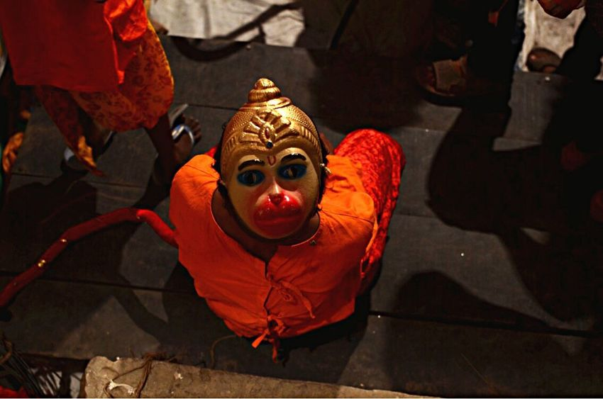An indian artist , dressed as Hindu monkey God Hanuman , prepares to perform his role in traditional ramleela , a play narrating the life of Hindu God King Rama , in the old streets of allahabad, india. Outdoors Clown India Photojournalism Photojournalist RamLeela  Arts Culture And Entertainment Allahabad ASIA People Life EyeEmNewHere