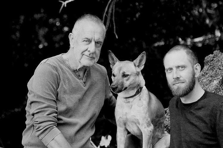Portrait of father and son with dog