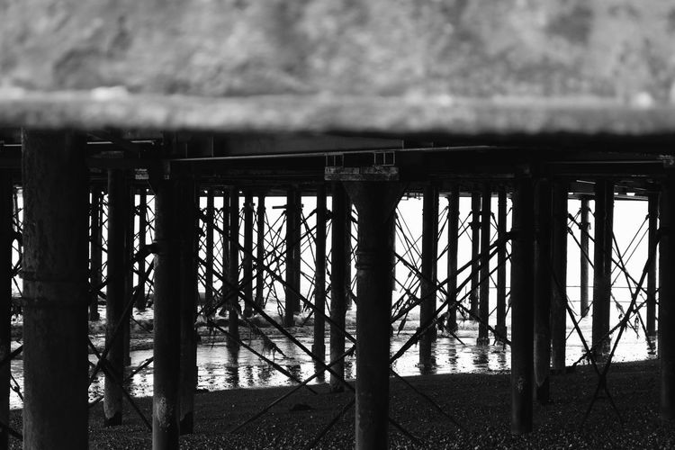 Under Southsea Pier Black & White Silhouette Southsea Pier Architecture Barrier Black And White Built Structure Damaged Day Metal No People Old Outdoors Protection Safety Security Shadow Southsea Sunlight