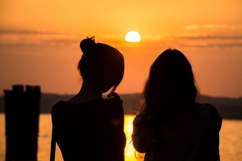 Ways Of Seeing Sunset Sky Real People Orange Color Women Lifestyles Two People Togetherness Adult Silhouette Sun Rear View Water Friendship Sea Scenics - Nature Beauty In Nature Bonding International Women's Day 2019