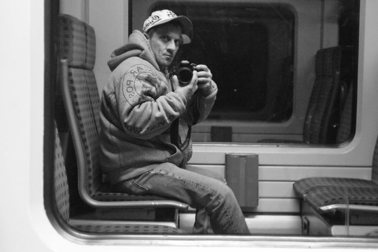 Blackandwhitephotography Black And White Photography Blackandwhite Photography Monochrome Self Portrait Selfportrait Self-portrait Monochrome Photography Glass Reflection Transportation Man Sitting On Bench Man Sitting Alone Traveling Train Welcome To Black