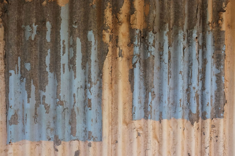 Paint on old corrugated iron. Corrugated Lines Abstract Backgrounds Close-up Corrugated Iron Cracked Paint Damaged Day Full Frame No People Pattern Pealing Paint Rusty Textured  Weathered