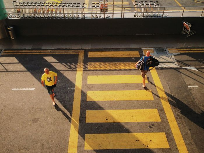 High angle view of men crossing road