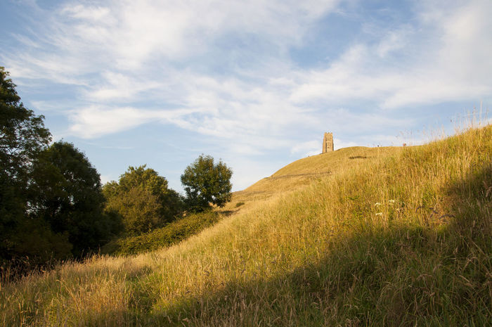 Glastonbury tor view Grass Sky Tranquility Landscape Tranquil Scene Grassy Plant Cloud Hill Cloud - Sky Beauty In Nature Solitude Cloudy Glastonbury Tor Field Tree Scenics Nature Day England