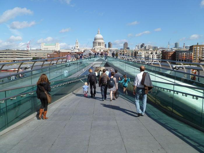 People on london millennium footbridge against st paul cathedral