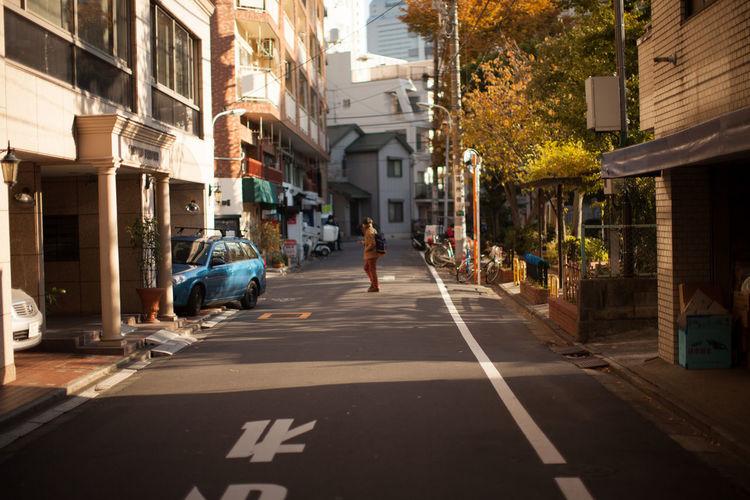 Pedestrian standing on street