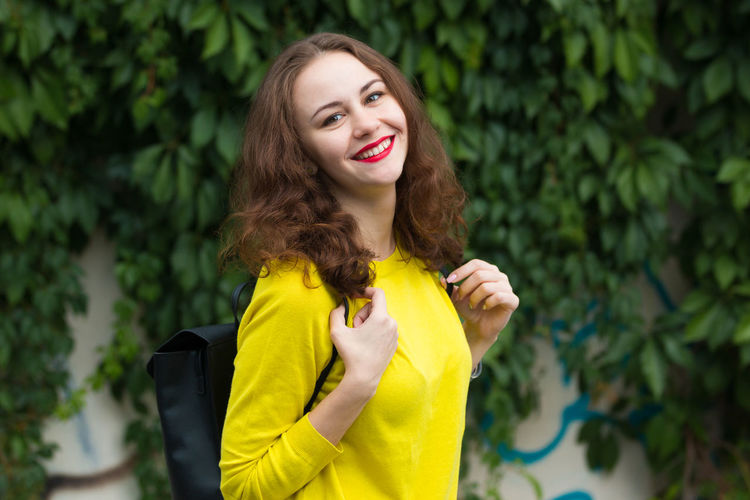 Beautiful People Beautiful Woman Beauty Beauty In Nature Cheerful Close-up Day Flower Focus On Foreground Freshness Green Color Happiness Long Hair Looking At Camera Nature One Person One Young Woman Only Outdoors Portrait Real People Smiling Tree Yellow Young Adult Young Women Paint The Town Yellow