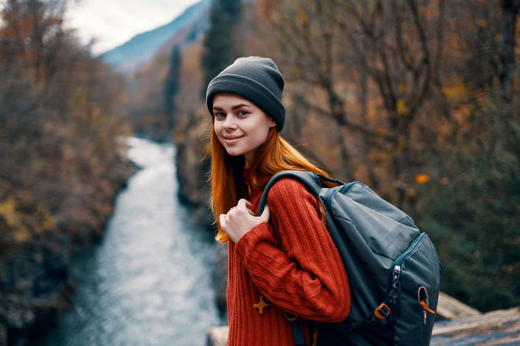 Portrait of young woman standing during autumn
