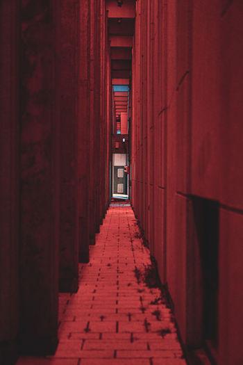 Narrow illuminated corridor of building