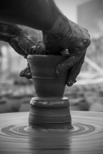 Close-up of human hand holding mud