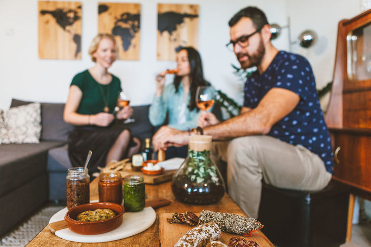 Friends Appetizer Casual Clothing Cosy Living Day Food Food And Drink Freshness Friendship Home Interior Human Hand Indoors  Men Party People Real People Sitting Smiling Sofa Standing Table Togethernees Togetherness Young Adult Young Women
