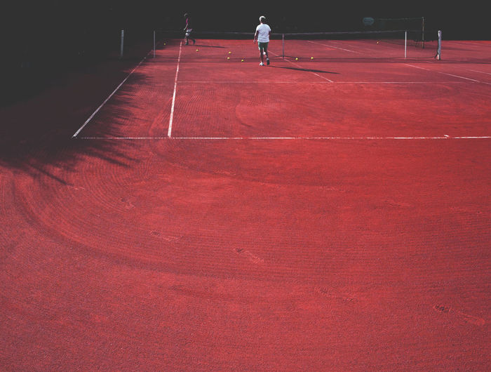 People At Tennis At Clay Court