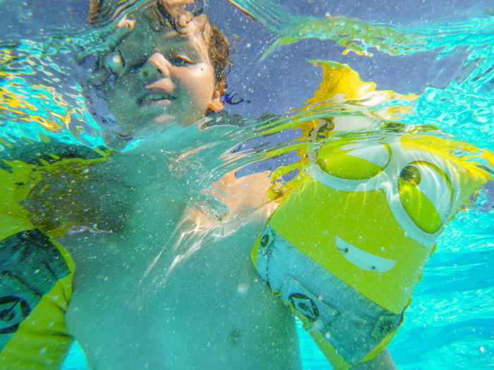 Blue Boy Child Childhood Day Eyewear Leisure Activity Lifestyles Men Nature One Person Outdoors Pool Real People Sea Shirtless Smile Smiling Swimming Swimming Pool Swimwear Underwater Water Yellow