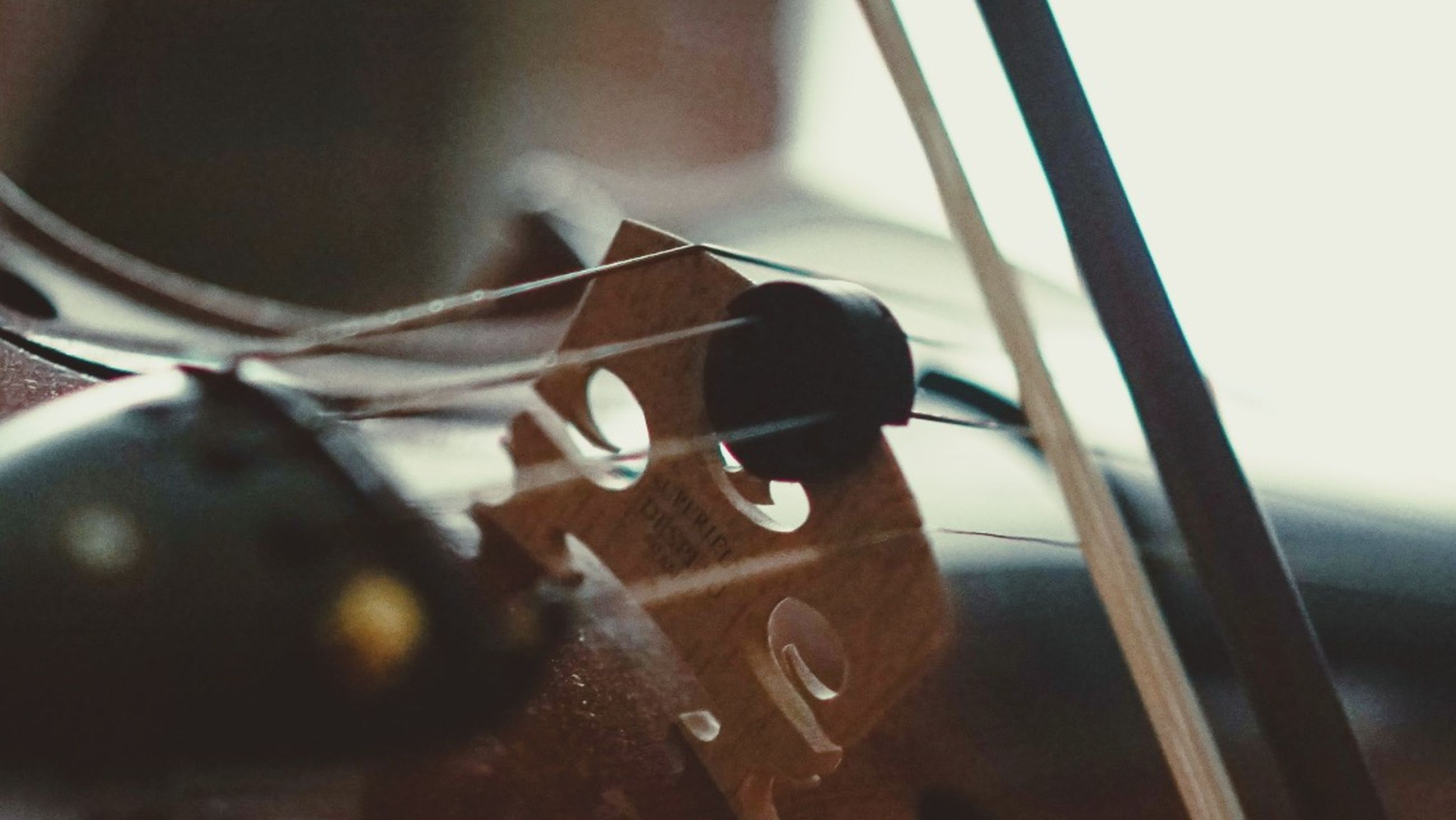 indoors, close-up, focus on foreground, still life, metal, selective focus, no people, single object, home interior, table, musical instrument, music, part of, art and craft, day, black color, wood - material, animal representation, window, art