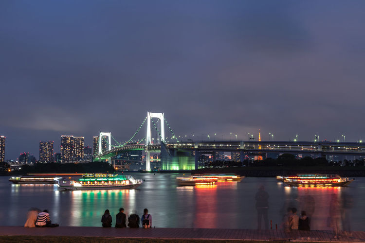 Bridge over river in city at night. night view of odaiba, tokyo. japan