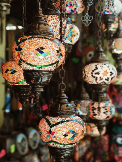 street lamps Hanging Market Retail  Close-up Souvenir Display Bazaar Shop Shelves Collection Street Market Raw Handmade Bauble Wind Chime For Sale Window Display Market Stall Summer In The City