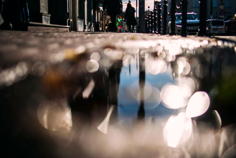 Surface Level Image Of Person Walking Wet Street During Rainy Season