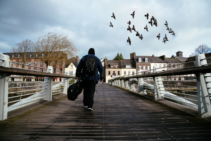 Beggar crossing bridge in Cork Cork EyeEm Best Shots EyeEm Selects Flock Of Birds Travel Wild Atlantic Way Architecture Beggar Bridge - Man Made Structure Canal Crossing Footbridge Landscape Large Group Of Animals Leisure Activity Lifestyles Nature One Person Outdoors Real People Rear View River Scenics Sky Solitude