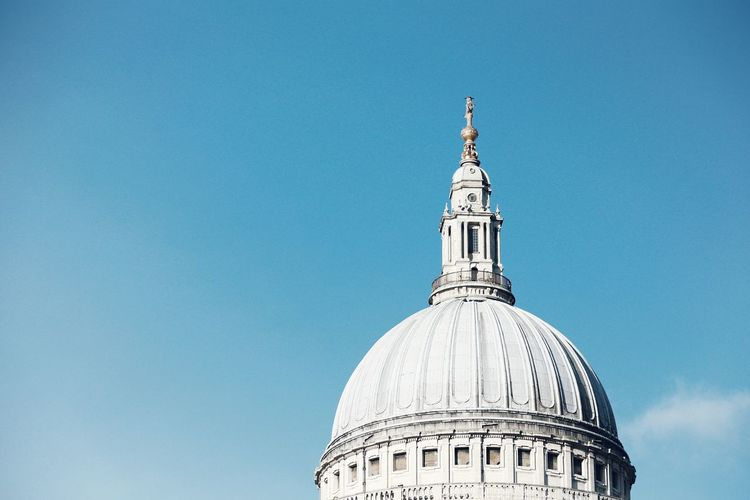 Low angle view of st paul cathedral against blue sky