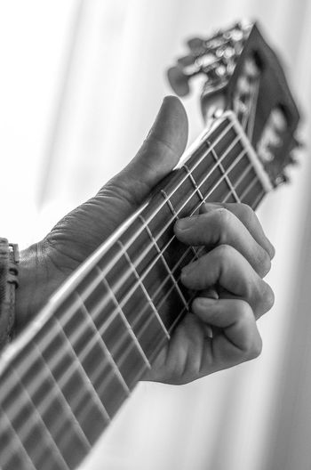 Acoustic Guitar Arts Culture And Entertainment Bass Guitar Classical Guitar Close-up Day Electric Guitar Fretboard Guitar Human Hand Indoors  Leisure Activity Music Musical Equipment Musical Instrument Musical Instrument String Musician One Person Playing Plucking An Instrument String Instrument Woodwind Instrument