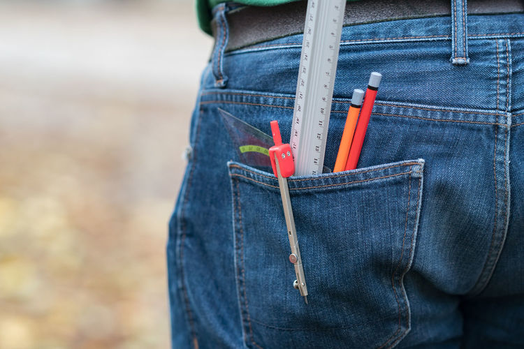 Coloring pencils in a back jeans pocket Artist Coloring Pencils Do It Yourself Art Back Pocket Casual Clothing Close-up Denim Jeans Drawing Jeans Outdoors Pencil Work Tool