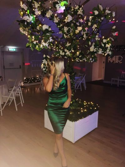 I'm in Essex girl.. Blonde Emeraldgreen Tree Plant One Person Celebration Decoration Full Length christmas tree Holiday Lifestyles Real People Christmas Women Rear View Illuminated Young Adult Leisure Activity Fashion Night Outdoors Dress