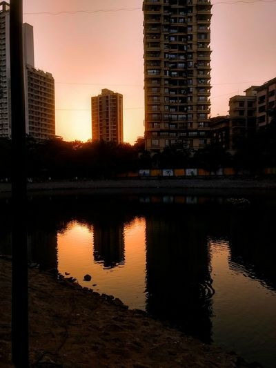 A reflection is something which lets you know who you truely are ❤ Sunset Skyscraper Cityscape Urban Skyline City Reflection Illuminated Outdoors Water No People EyeEmNewHere G4plus Full Length Mobileshot Sunset Lovers Sunset Evening Sky Eveningwalk Art Is Everywhere