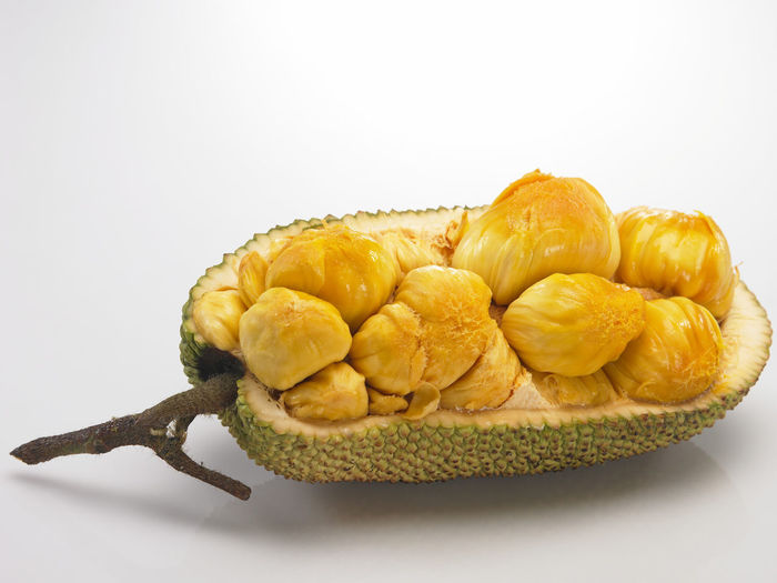 cempedak malaysia fruit Raw Tropical Fruits Asian Fruit Cempedak Close-up Exposed Food Food And Drink Freshness Half Healthy Eating No People Open Ready-to-eat Still Life Strong Smell Studio Shot White Background Yellow
