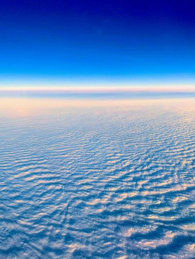 Scenic view of clouds over blue sky