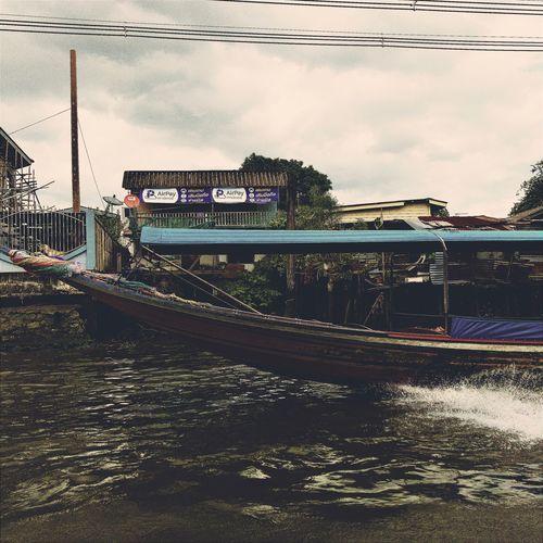 Long tail boat on the Bangkok Yai khlong Hipstamatic Boat Longtail Boat Thailand Bangkok Eyeem_philippines IPhoneography NEM Submissions Mobilephotography AMPt_community Eye4thestreets Water Transportation Sky Mode Of Transportation